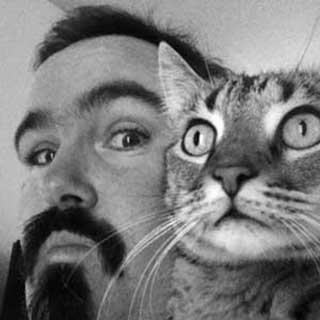 Extreme closeup of Al Sparrow and his cat