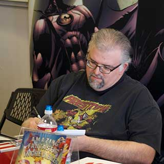 Artist Dave Beaty sketching during Free Comic Book Day 2015 at Game On! in Prescott Valley, AZ.