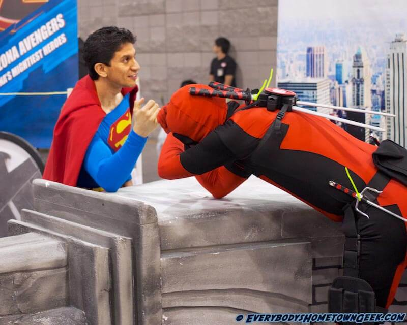 Superman vs. Deadpool in arm wrestling... I don't think Deadpool is doing well...